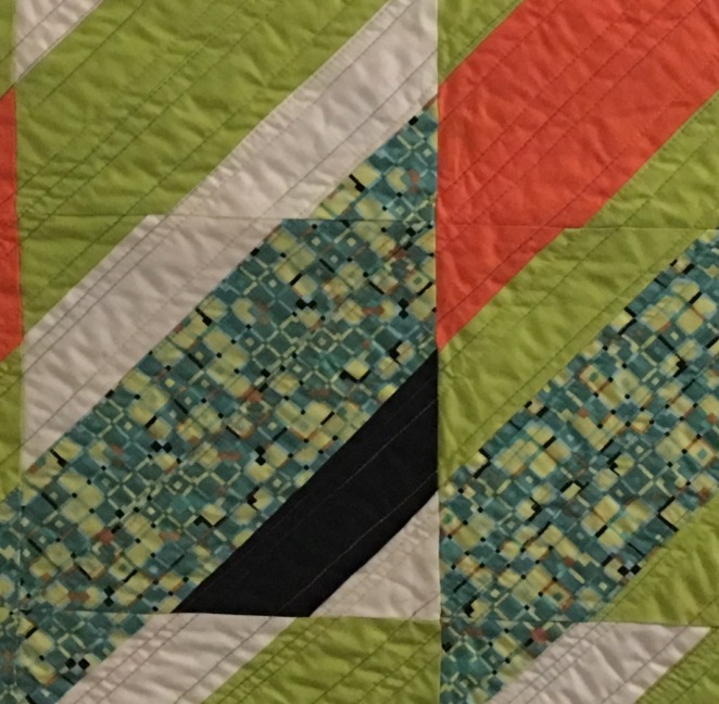 orange white black green quilt